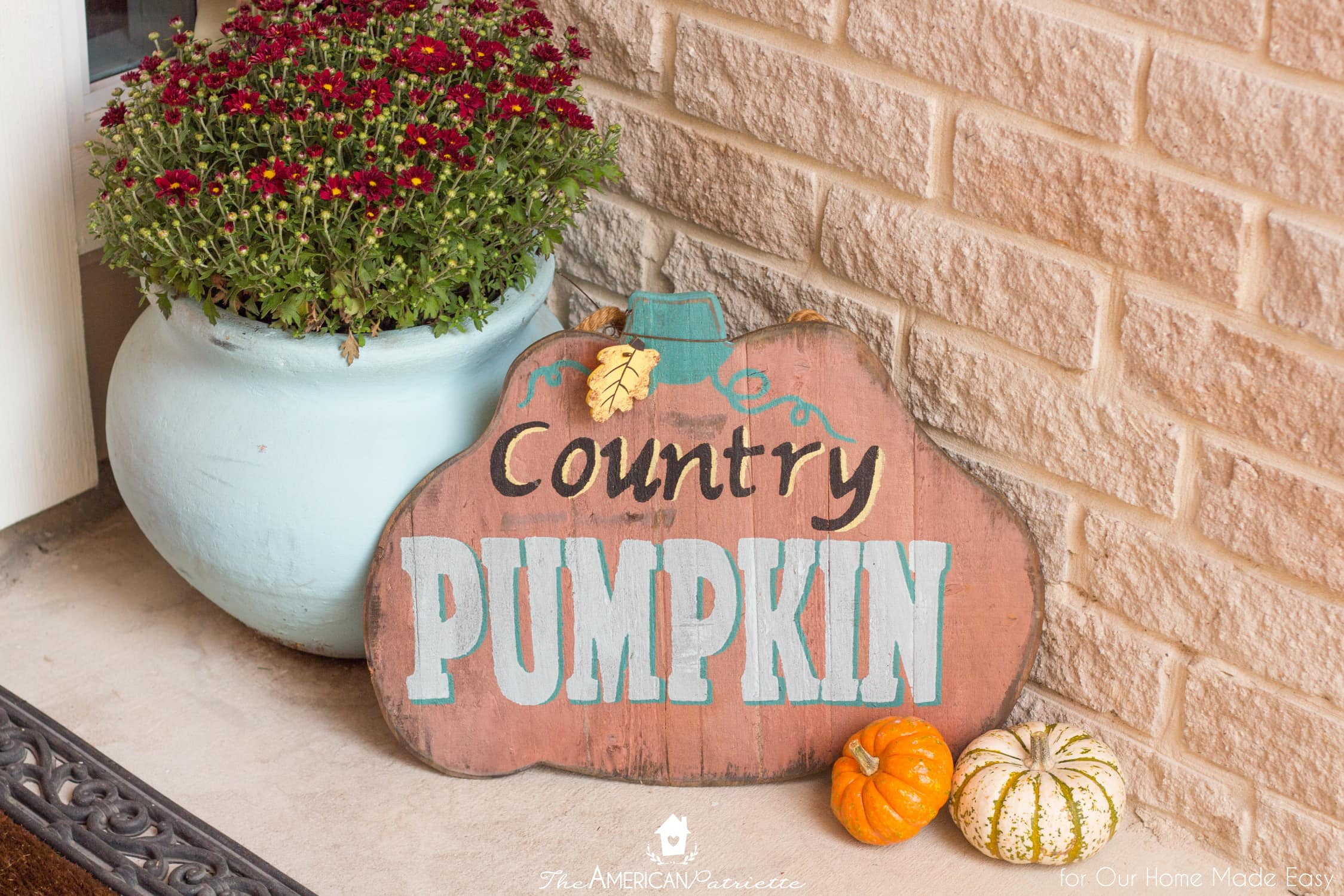 Colorful signs like this country pumpkin sign is a great way to add fun color to your porch