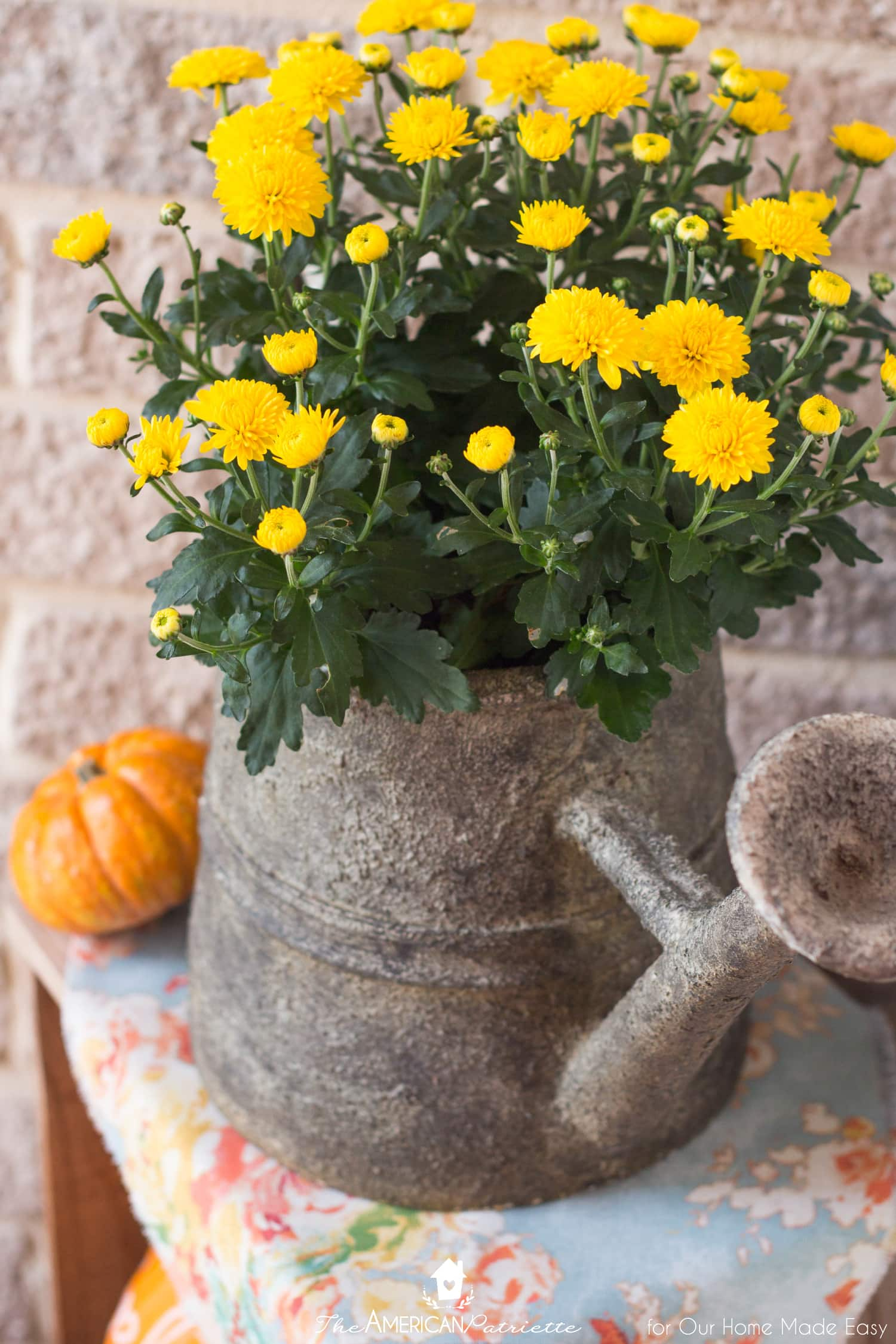 Adding bright flowers to your front porch is an easy way to add pops of color