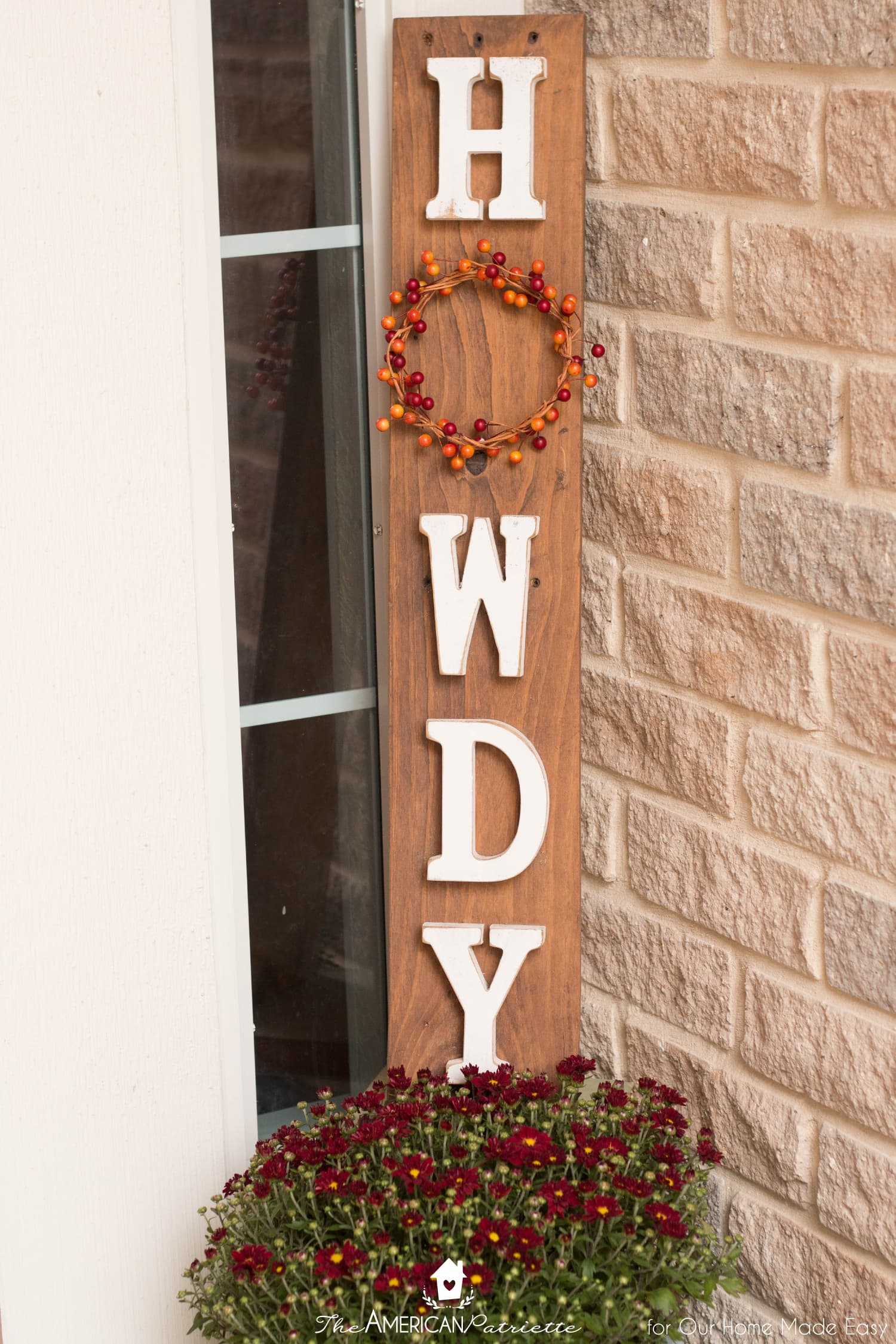 This wood Howdy sign has small pops of color