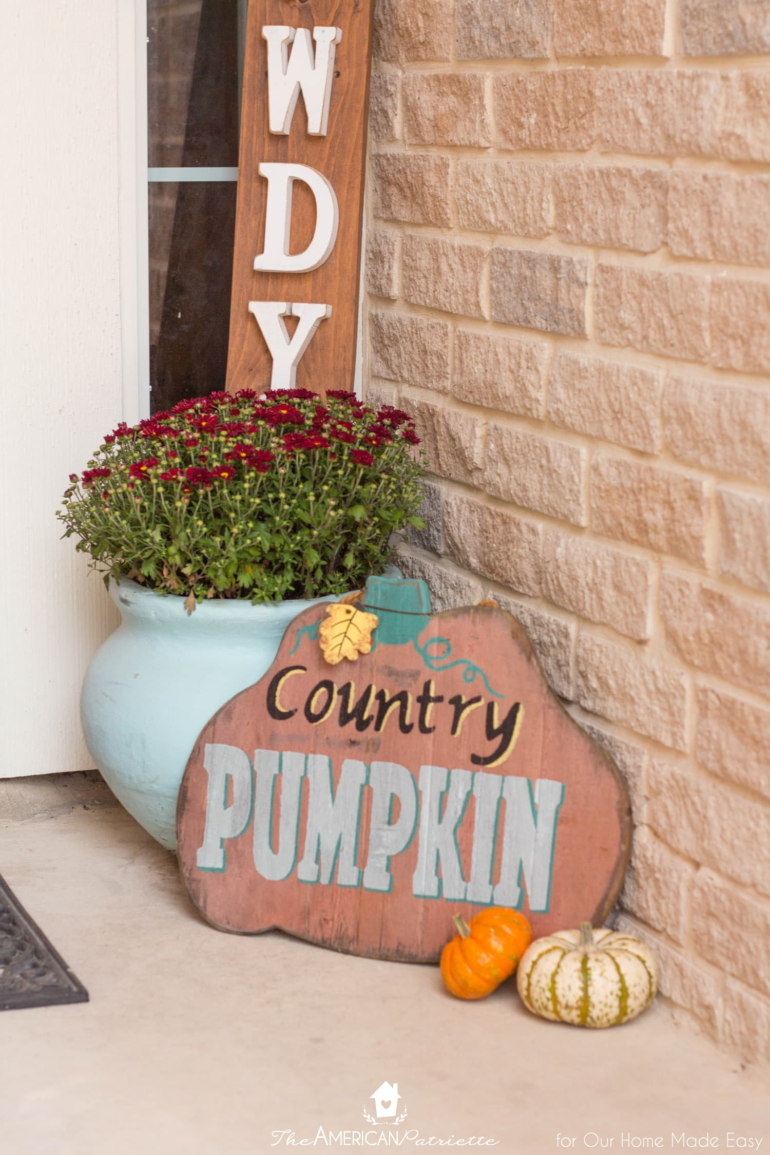 This fall themed front porch is packed with pops of color
