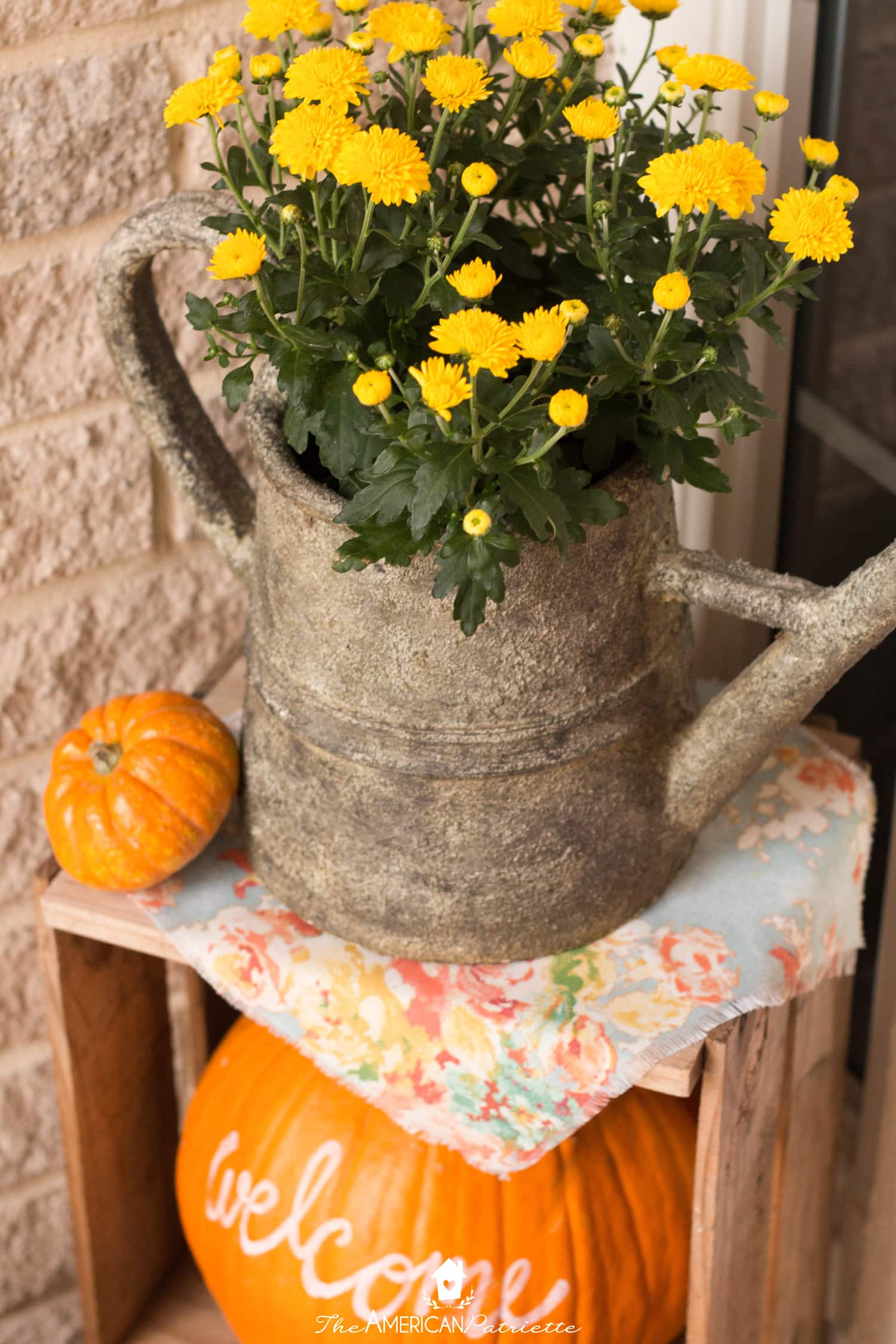 A fall front porch isn't complete without some pumpkins