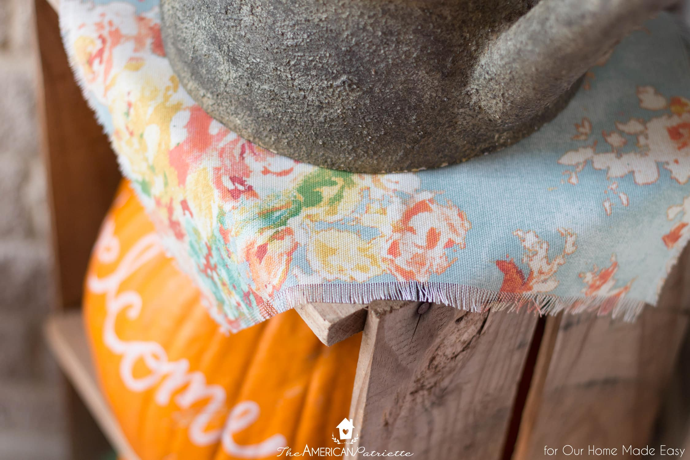 Colorful fabric is an easy way to add to your front porch decor